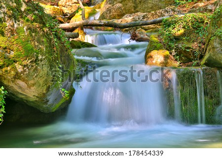 Landscape with Nice small waterfall on mountain river