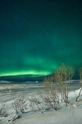 Landscape with northern lights  on the coast of the Barents Sea on the Kola Peninsula at night at high ISO sensitivity