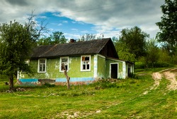 landscape with old, forgotten houses, abandoned somewhere in the villages of Moldova. Abandoned house in Republic of Moldova. Depopulation concept.