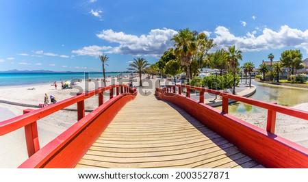 Landscape with red boardwalk at the coastline of Platja de Muro in Alcudia bay, Majorca Island, Spain Foto d'archivio ©