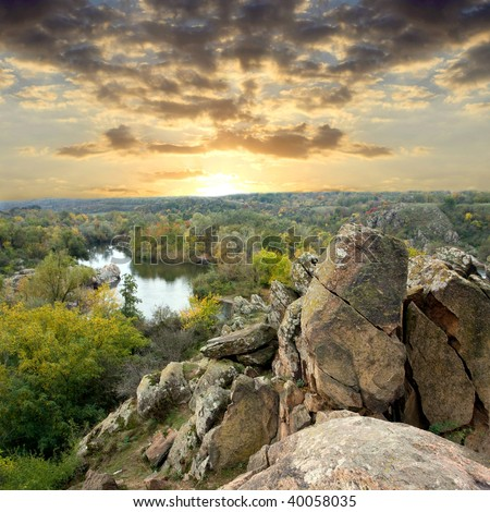 Landscape with rock in forest at sunset #40058035