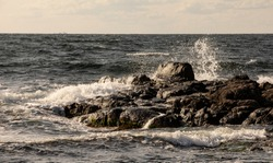 landscape with rocks and blue sky, rocky coast of the island of Bornholm in the Baltic Sea