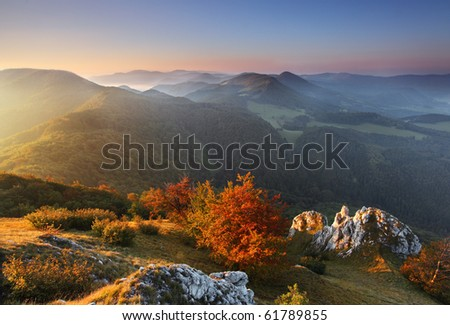 Landscape with rocky mountains at sunrise