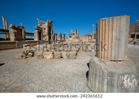 Landscape with ruined city and stone columns in Persepolis, Fars Province, Iran. UNESCO World Heritage Site.