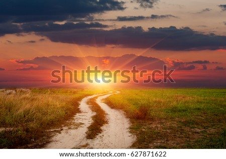 landscape with rut road on sunset sky background #627871622