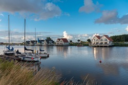 Landscape with sailboats and yachts on the river Harle in Harlesiel. Harlesiel is a holiday resort in East Frisia and is located on the North Sea coast in Germany.