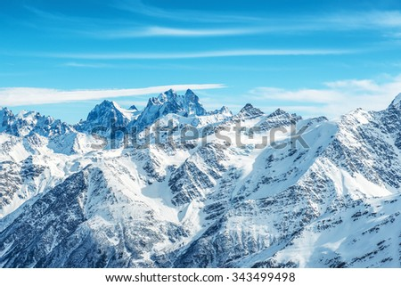Landscape with snow in blue mountains over sky and clouds #343499498