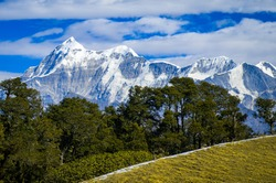 Landscape with snow. Scenic view of the Himalayan snow-covered mountain range, on a trek to Bramatal, Uttarakhand, India.