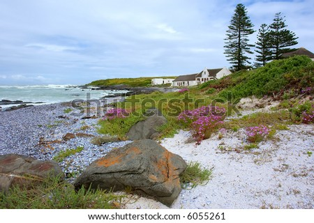 Landscape with stone and house on beautiful beach. Shot on West Coast, between Grotto Bay nature reserve and Silwerstroomstrand, Western Cape, South Africa.