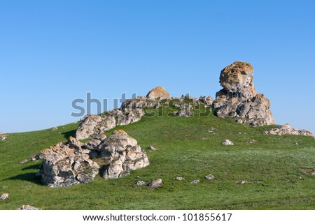 Landscape with stones on green hill