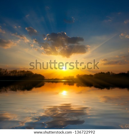 landscape with sunset over lake