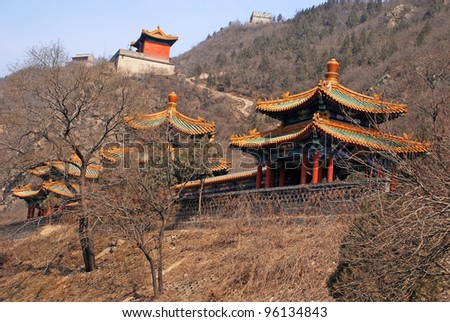 Landscape with three chinese pagoda on hills near Great Wall in early spring.