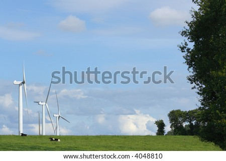 Landscape with three windmills in the countryside