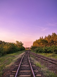 landscape with train railway tracks nature at sunset