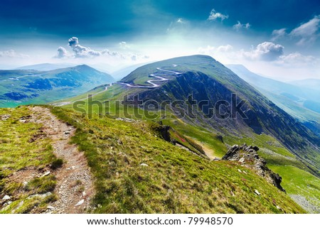 Landscape with Transalpina road and Urdele peak of Parang mountains in Romania - stock photo