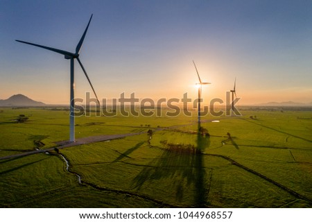 Landscape with Turbine Green Energy Electricity, Windmill for electric power production, Wind turbines generating electricity on rice field at Phan Rang, Ninh Thuan, Vietnam. Clean energy concept.
