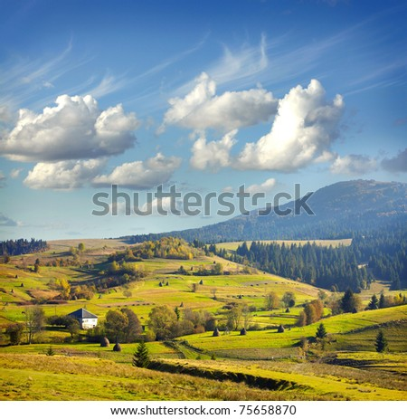 Landscape with village, mountains and blu sky