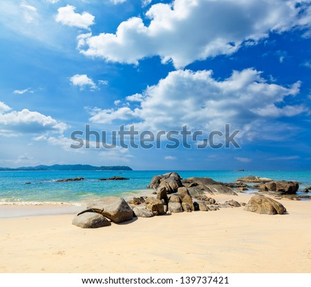 Landscape with white beach, the sea and the beautiful clouds in the blue sky #139737421