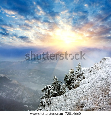 Landscape with winter evening in mountains