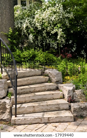 Landscaped front yard with natural stone steps