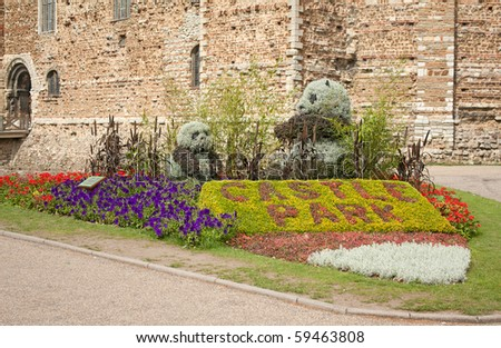 Landscaped garden with colourful flowers and two bears.