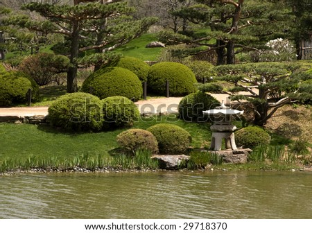 Landscaped view of botanical garden with Japanese garden sculpture.
