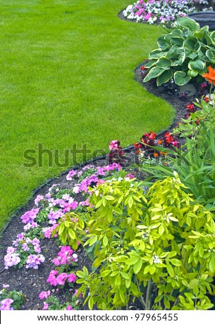 Landscaped Yard and Garden. A beautiful landscaped yard and garden with a variety of perennials and annuals.
