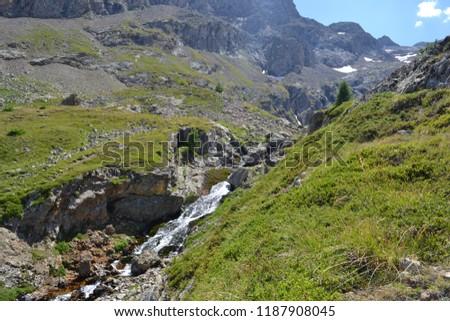 Landscapes of the Hautes-Alpes, mountain stream along a hiking trail, La Grave, Ecrins National Park, Alps, France