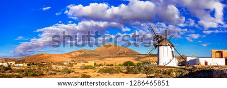 landscapes of volcanic Fuerteventura - view with traditional winndmills. Canary islands of Spain