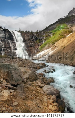 landscapes with picturesque waterfall and rapid mountain river, Banff National Park, Alberta, Canada