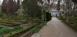 Landscaping and garden design. Panorama view of the plants, trees, Buxus sempervirens flower beds, flowers and pathwalk across the Royal Botanic Garden of Madrid, Spain.