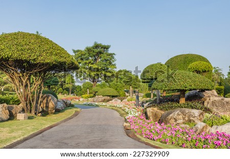 Landscaping stones and flowers adorn the bright beauty of the park. #227329909