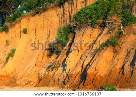 Landslide, rockfall on steep slopes of limestone mountains of northern Black Sea coast. Zone of natural disasters during rainy season. Large masses of earth slip along slope of hill, destroy houses. #1016756107