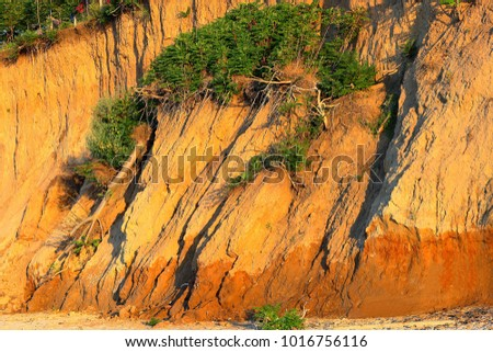 Landslide, rockfall on steep slopes of limestone mountains of northern Black Sea coast. Zone of natural disasters during rainy season. Large masses of earth slip along slope of hill, destroy houses. #1016756116