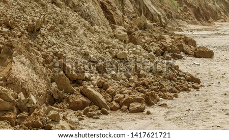 Landslide zone on Black Sea coast. Rock of sea rock shell. Zone of natural disasters during rainy season. Large masses of earth slip along slope of hill, destroy houses. Landslide - threat to life #1417621721