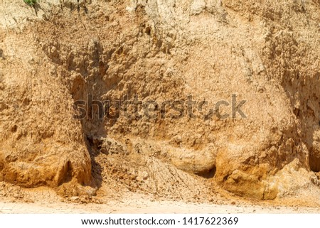 Landslide zone on Black Sea coast. Rock of sea rock shell. Zone of natural disasters during rainy season. Large masses of earth slip along slope of hill, destroy houses. Landslide - threat to life #1417622369