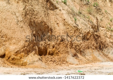 Landslide zone on Black Sea coast. Rock of sea rock shell. Zone of natural disasters during rainy season. Large masses of earth slip along slope of hill, destroy houses. Landslide - threat to life #1417622372
