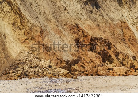 Landslide zone on Black Sea coast. Rock of sea rock shell. Zone of natural disasters during rainy season. Large masses of earth slip along slope of hill, destroy houses. Landslide - threat to life #1417622381