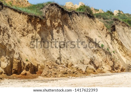 Landslide zone on Black Sea coast. Rock of sea rock shell. Zone of natural disasters during rainy season. Large masses of earth slip along slope of hill, destroy houses. Landslide - threat to life #1417622393
