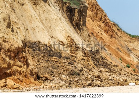 Landslide zone on Black Sea coast. Rock of sea rock shell. Zone of natural disasters during rainy season. Large masses of earth slip along slope of hill, destroy houses. Landslide - threat to life #1417622399