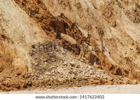 Landslide zone on Black Sea coast. Rock of sea rock shell. Zone of natural disasters during rainy season. Large masses of earth slip along slope of hill, destroy houses. Landslide - threat to life #1417622402