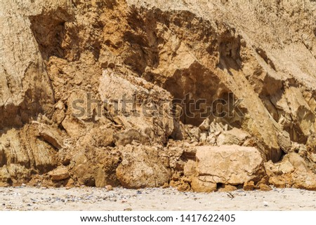 Landslide zone on Black Sea coast. Rock of sea rock shell. Zone of natural disasters during rainy season. Large masses of earth slip along slope of hill, destroy houses. Landslide - threat to life #1417622405