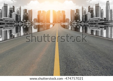 Lane blacktop in the colorful city with beautiful skyscrapers background.