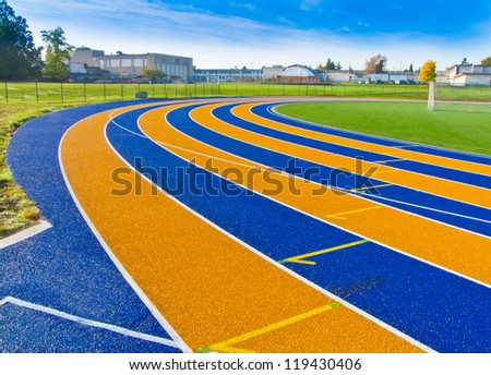 Lanes of a yellow and blue race track.