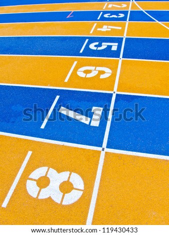 Lanes of a yellow and blue race track. Numbered colorful lanes.