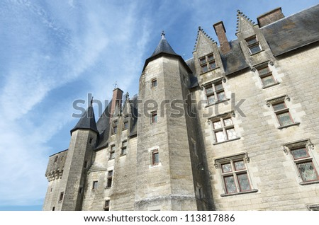 LANGEAIS, FRANCE - AUGUST 20: Castle on August 20, 2012 in Langeais: Built in the 15th century on the ruins of an ancient fortress, is an example of architecture from the late medieval period.