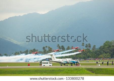 LANGKAWI, MALAYSIA - MAR 26: Malaysia Aerobatic Team X330L Krisakti performing during on LIMA'13 - Langkawi International Maritime & Aerospace Exhibition on Mar 26, 2013 in Langkawi, Malaysia.