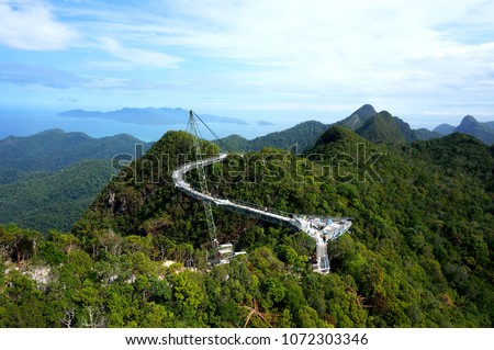 Langkawi Sky Bridge is a 125-meter curved pedestrian cable-stayed bridge in Malaysia, completed in 2005 #1072303346