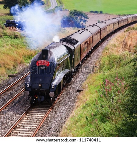 LANGWATHBY, ENGLAND - SEPTEMBER 1: Preserved Sir Nigel Gresley steam locomotive Union of South Africa is pictured south of Langwathby, England on September 1, 2012, on the Settle to Carlisle railway.