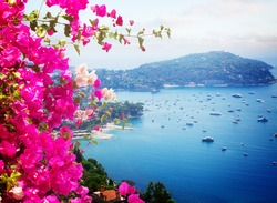 lanscape of coast and turquiose water of cote dAzur with flowers, French Riviera, France